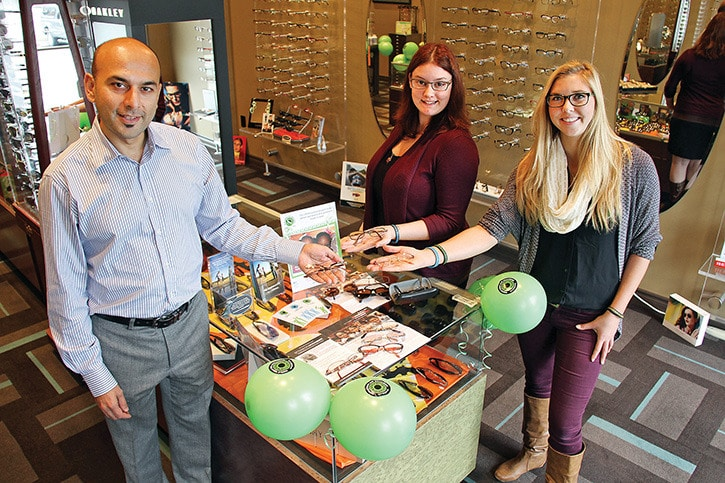 Don DEscoteau/News Gazette staff Oct. 8, 2015 -- Dr. Gurpreet Leekha, left, and staff members Lindsay Percival and Kelsey Impett of Eye Etiquette in Millstream Village show some of the used eyeglasses donated for use in countries without adequate vision care facilities. Thursday was World Sight Day and the store was matching donations from the public toward the Optomertry Giving Sight program.