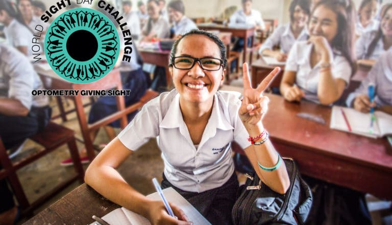Young woman in glasses showing the peace sign for World Sight Day Challenge.
